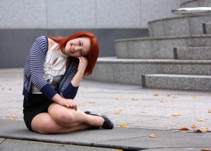 Young business woman sitting on steps